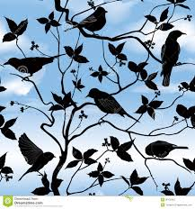 spring floral seamless wallpaper with birds on branches over blue