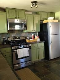 light brown kitchen cabinets with black appliances home living green kitchen with black appliances