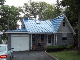 blue metal roof on charming lakehouse cottage ideas for the