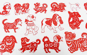 themed paper folk artist creates scroll of dog themed paper cuts