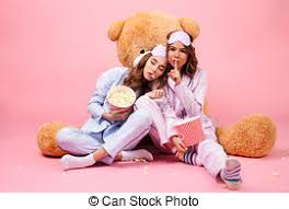 best friends watching tv or a movie in bed stock photo images 37