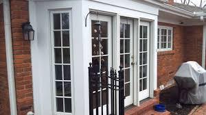 exterior design inspiring pella doors for door ideas jones pella doors in white with dorknob handle matched with bricked wall and flooring for exterior decor