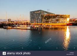 harpa concert hall at sunset reykjavik iceland stock photo