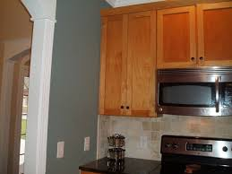 sherwin williams paint with oak cabinets sherwin williams oyster bay obsessed paint for kitchen
