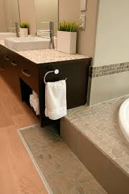 Stone Bathroom Vanities Bathroom Pebble Tile And Tub Surround With Wooden Flooring For