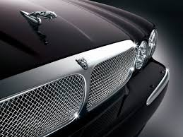 2006 jaguar v8 portfolio leaping cat 1024x768 wallpaper