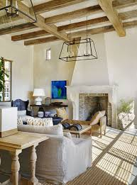 mediterranean furniture style library den with fireplace and