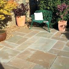 Flagstone Patio On Concrete by How To Lay Paving Slabs On Uneven Concrete Flagstone Patio Gray