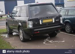 range rover sedan range rover car parked in a disabled parking space stock photo