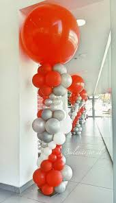 balloon delivery westchester ny bright balloon columns in orange white and silver balloon