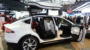 tesla unveils model x car with falcon wing doors bbc news