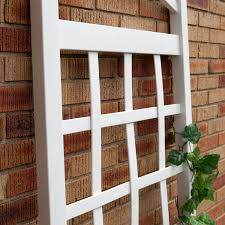 6 ft white vinyl garden trellis with arch top with ground mount