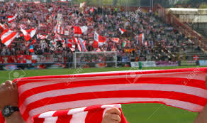 red and white scarf of the fans in the stadium during a football