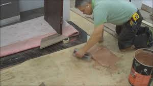 How To Put Laminate Flooring Down How To Installing Hardwood Flooring Glue Down In The Basement
