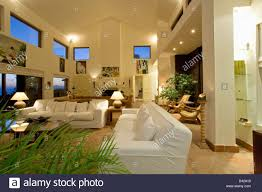 white sofas in large double height living room in modern spanish