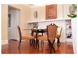 dining rooms beige microfiber chair natural stone fireplace white full size of dining room furniture gold beige cowhide red curtains hardwood flooring floor mirrors fireplace