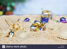 ornaments in the sand silver packages stock photo