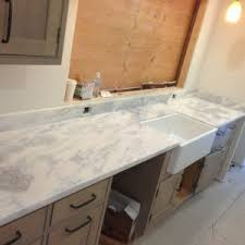Sky Kitchen Cabinets Kitchen Custom Quartzite Countertops With Laminate Wood Flooring