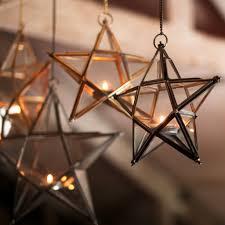 zinc or brass and glass star tealight holder