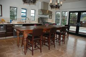 brown wooden kitchen island with four legs plus brown wooden