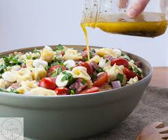 a pasta salad made with cheese tortellini asparagus mozzarella