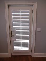 Window Treatment For French Doors Bedroom French Door Shutters Traditional Bedroom New York By The