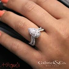 teardrop diamond ring the combination of the teardrop diamond and the curved band is