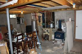 concrete half wall in the basement by the door can we tear it out