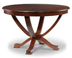 furniture brown wooden expanding dining table on floral carpet in