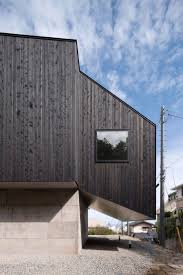best images about japanese houses pinterest kenzo tange cubo design architect pairs blackened wood with concrete for house coastal japanese city