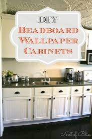 transform old cabinets with this diy beadboard wallpaper cabinet