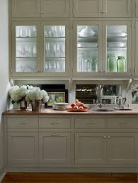 Glass Shelves For Kitchen Cabinets Traditional Butler U0027s Pantry Features Glass Front Upper Cabinets