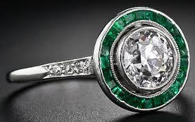 art deco diamond engagement ring with calibre emeralds
