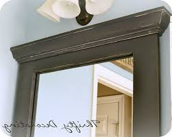 marble framed mirror with chair rail molding trim border also
