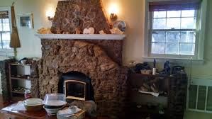 coordinate paint color with old ugly stone fireplace