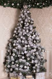 decorated silver tree on silver decorations snowflakes