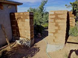 alt build blog building an adobe wall 6 plastering and