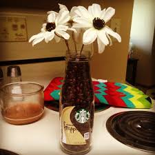 coffee themed home decor starbucks bottle with coffee beans with some simple flowers for a