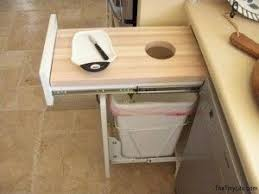 kitchen space saver ideas kitchen cutting board garbage can space saver idea www