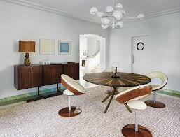 an art deco miami villa turned furniture showcase wsj a custom version of christophe delcourt s ile dining table the chairs by ricardo fasanello