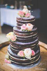 4 tiered dark chocolate brownie cake filled with vanilla