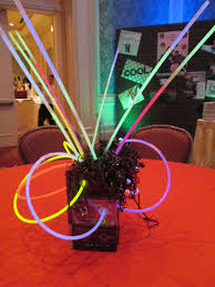 encore 80s centerpiece with stacked cassette tapes and glow
