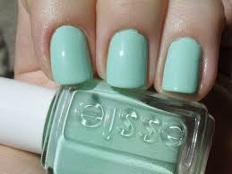 lacquered painted polished three essie green nail polishes