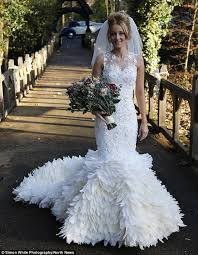 wedding dresses 200 spends 200 hours stitching 22 000 feather to create
