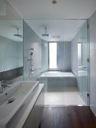 love the mosaic blue tiles and the tub shower combo enclosure