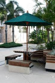 Outdoor Sitting Area Table Chairs And Umbrella Outdoor Seating Area Stock Photo