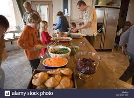 american family serving traditional thanksgiving dinner buffet