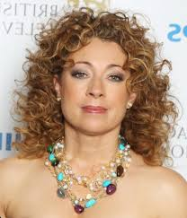 hairstyle layered haircuts for wavy layered curly