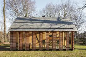 small country home modern small country cottage with wooden shutters in the netherlands