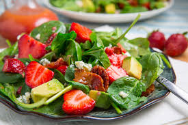strawberry and avocado spinach salad in raspberry balsamic